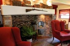 Open hearth, walk-in fireplace, brick fireplace